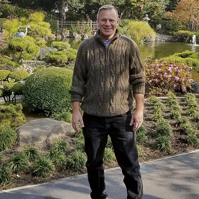 Game design student Richard Mulliner standing outdoors.