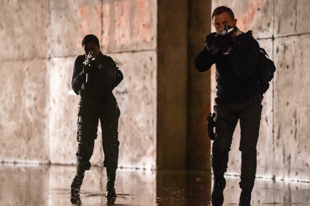 "Nomi (Lashana Lynch) and James Bond (Daniel Craig) in ""No Time To Die."""